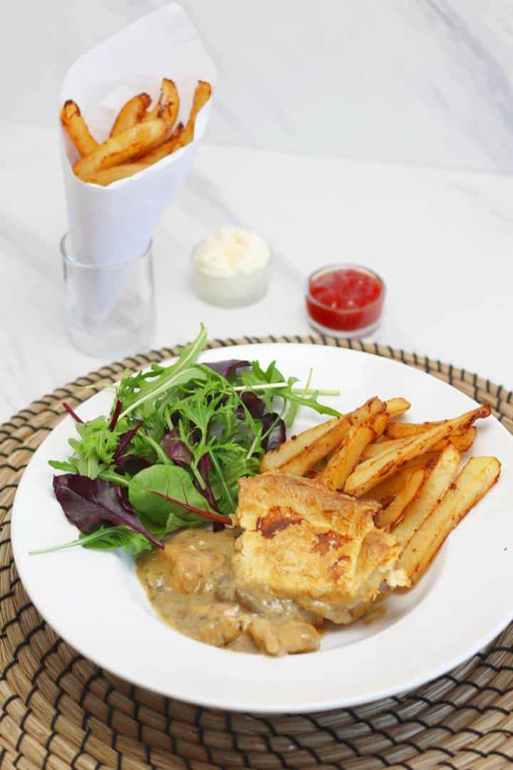 chicken casserole with belgian frites and salad
