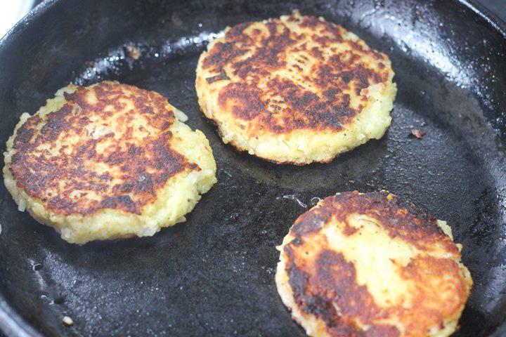 potato patties in skillet