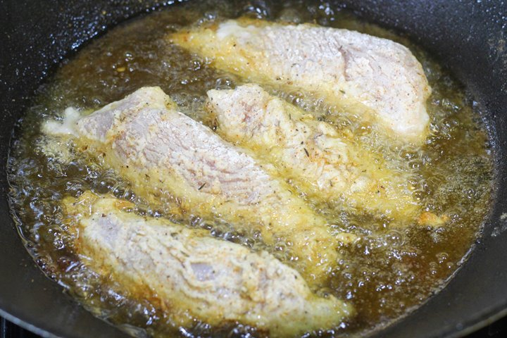 frying buttermilk chicken in wok
