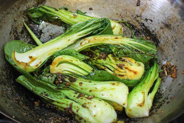 pak choi in the wok
